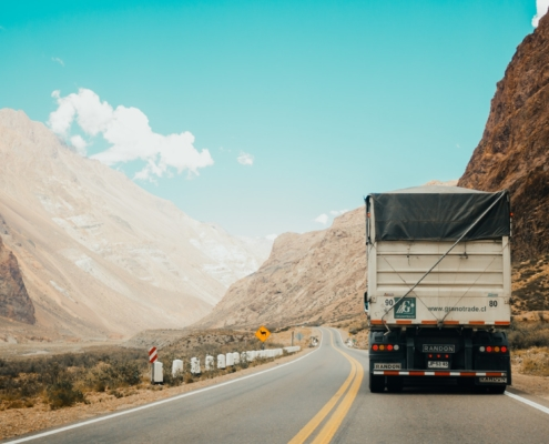 Import export blog Truck transporting goods over a mountain pass