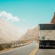 Truck transporting goods over a mountain pass